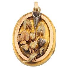 14k Victorian  floral locket with 4 leaf clover pressed inside