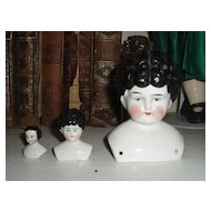 "Three wonderful antique china doll heads 1 1/4 "" to 4"""