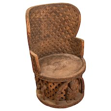 Ornately Carved African Wooden Chair from the Ivory Coast