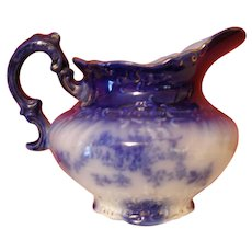 Flow blue Wheeling pitcher