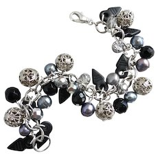 Edgy Charm Bracelet in Blacks, Greys, Silver Tones and Crystal