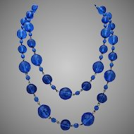 Long Sapphire Colored Faceted Glass Necklace,  39 Inches