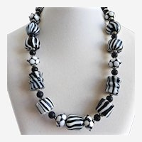 "Necklace of Handmade Black and White Striped Glass Beads, 19""-–22"""