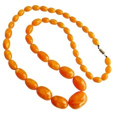 Graduated Necklace of Orangey Acrylic Beads, 30 inches