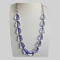 Necklace of Water Clear Blue Lined Lucite Beads on Cord, 32""