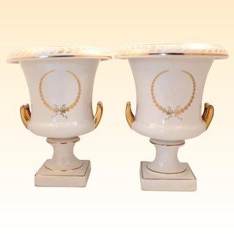 Two white porcelain flower vases