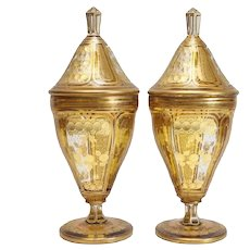 Pair Bohemian Gilt Amber Glass Intaglio Cut to Clear Covered Urns, 20th Century