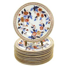 12 Royal Worcester Hand Painted Porcelain Bread and Butter Plates, 1884.