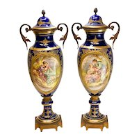 Pair Sevres Style Hand Painted Porcelain Double Handled Decorative Urns, circa 1900