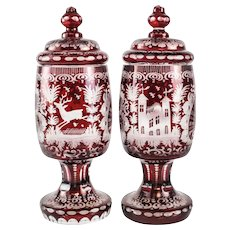 Pair Bohemian Art Glass Cranberry Over Clear Etched Lidded Urns, circa 1920