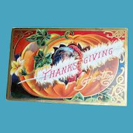Thanksgiving Greetings Postcard (Turkey Peeking Out of Pumpkin)