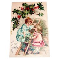 A Glad Xmas Postcard (Children on Ladder Trimming Tree)