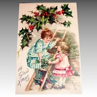 A Glad Xmas Postcard (Children on Ladder Trimming Tree)