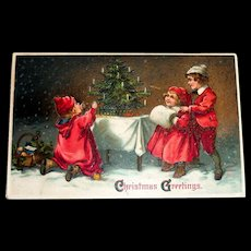 Christmas Greetings Postcard (3 Children in Red Admiring Christmas Tree)