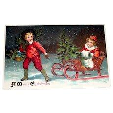 A Merry Christmas Postcard (Boy Pulling Girl & Tree On Sled) - 1911