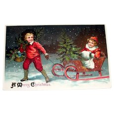A Merry Christmas Postcard (Boy Pulling Girl & Tree On Sled) - 1911