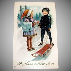 A Happy New Year Postcard (Girl with Muff & Boy With Sled)