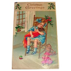 Christmas Greetings Postcard (Little Girl Rocking Her New Doll)