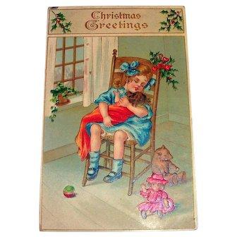 Christmas Greetings Postcard (Little Girl Rocking Her New Doll)