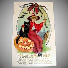 Hallowe'en Postcard (Pretty Witch in Red Sitting on Pumpkin)