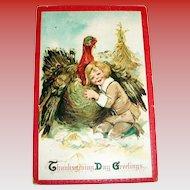 Frances Brundage: Thanksgiving Day Greetings Postcard (Pilgrim Boy Hugging Turkey)
