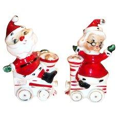 Mr. & Mrs. Santa Claus On Train Engines Porcelain Salt & Pepper Shakers