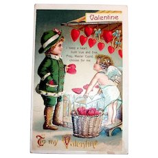To My Valentine Postcard (Boy/Girl Buying Valentines From Cupid) Signed