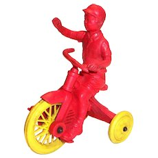 Auburn Boy On Tricycle Toy