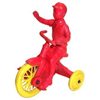 Auburn Boy On Tricycle Toy
