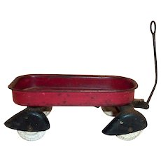 Small Red Metal Toy Wagon With White Wheels
