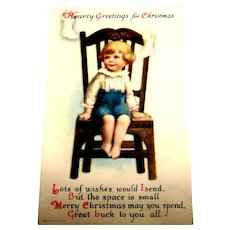 Hearty greetings for Christmas Postcard (Little Boy Sitting On Chair)