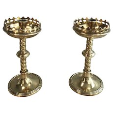 Pair of English Gothic brass ecclesiastical candlesticks