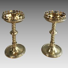 Pair of English Gothic brass ecclesiastical candlesticks