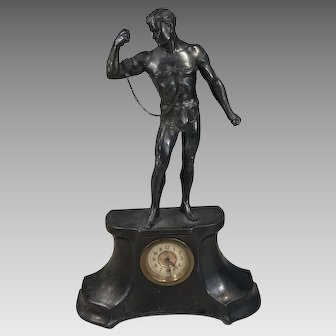 Antique spelter clock with male statue