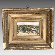 Antique framed landscape painting in oil of harvest scene haystacks and rolling hills