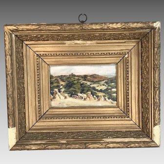Antique framed landscape painting in oil of harvest scene haystacks and rolling hills