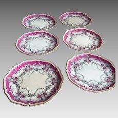 Set of 6 19th Century Continental porcelain plates gilt edging urns floral ornamentation
