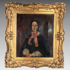 Antique Georgian portrait in oil of austere lady in gilt frame