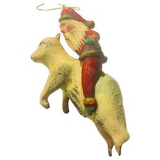 Carved Santa Riding a Bear Folk Art Ornament Signed Iauquet 1995
