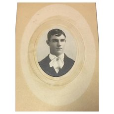 Antique Formal Portrait of a Young Man in Oval Cut Beveled Mat