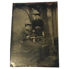 A Victorian Tin Type Studio Portrait of 2 Women with Festooned Hats
