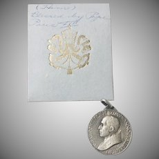 Pope Pius XII  Silver-tone Medallion in Original Folder marked Blessed by Pope Pius  1950s
