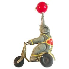 Vintage Tin Wind-up Elephant on Bike/Tricycle with Spinning Ball