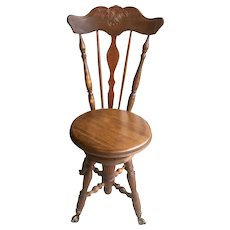Antique American Tiger Oak Adjustable Piano Chair with Claw Foot Glass Ball Feet, 1900