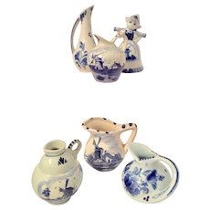 Delft set of 6 Porcelain Miniature Pitchers and Figurine  signed
