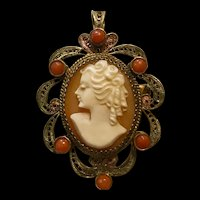 A lovely 900 silver vermeil enamel  carved shell cameo set with salmon coral accents