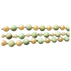 A vintage beaded jade and pearl triple strand bracelet set with a sterling filigree clasp.