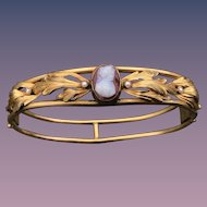 A lovely antique hardstone cameo seed pearl bangle