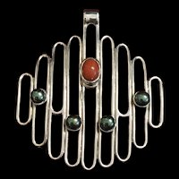 "A modernist style 950 silver signed ""Exel Tapia""  silver pendant set with grey pearls and coral."