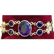 A gorgeous vintage gilt brass filigree bezel set amethyst glass bracelet